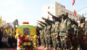 Hezbollah Military Salutes Al Hajj Coffin (Photo Credit: Al Manar)