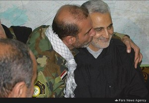 Soleimani being kissed by a leader from Shiite Militia Kata'ib Saeed al Shuhada