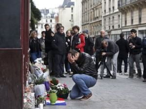 Man Mourns At The Carillon (Photo Credit- AP:Thibault Camus)