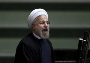 Iranian President Hasan Rouhani speaks before parliament, in Tehran, 2013. (AP Photo/Ebrahim Noroozi)
