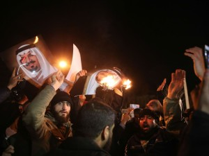 Iranian Protestors at KSA Embassy (Photo Credit- Reuters)