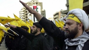 Hezbollah fighters take an oath during a parade to continue the path of resistance against Israel. (photo credit- AP:Hussein Malla)