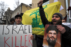 Protestors shout anti-Israel slogans in front of the Israeli embassy holding a portrait of Hezbollah leader Hassan Nasrallah in Moscow in 2012 (Photo- AFP)